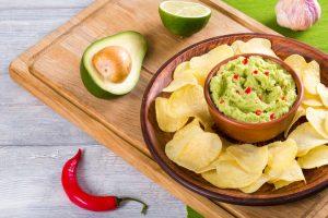 bowl of guacamole dip and potatoes